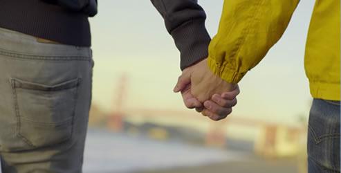 men_holding_hands